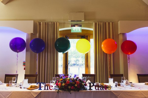 Rainbow Wedding Top Table http://www.babbphoto.com/