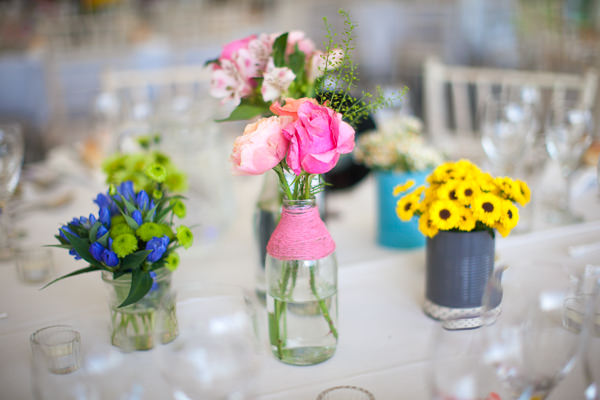 Colourful Fun Candy Wedding Flowers Bottles http://www.julietteharrison.co.uk/