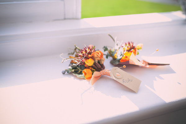 Country Vintage Homemade Wedding Orange Buttonholes http://www.sophieduckworthphotography.com/