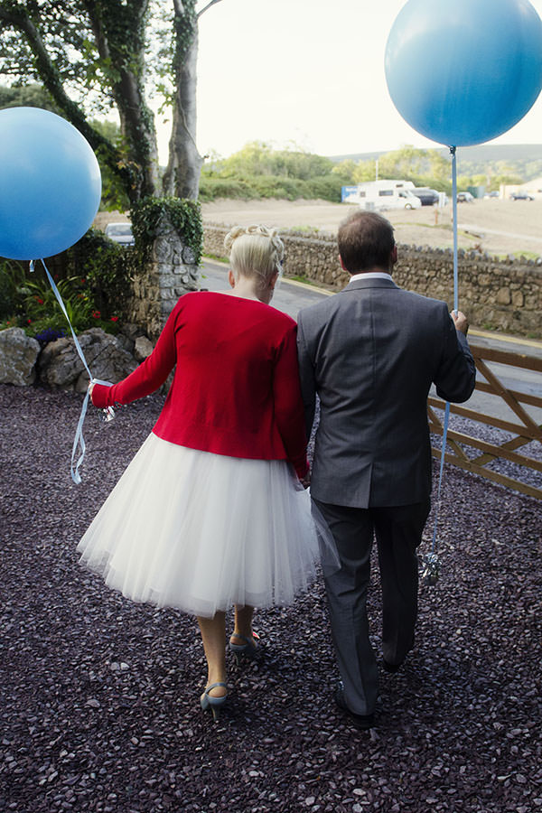 1950s Seaside Wedding Balloons http://www.amyradcliffephotography.com/