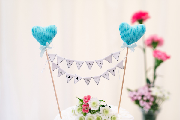 Country Garden Camping Marquee Wedding Knitted Heart Bunting Cake Topper http://www.chebirchhayesphotography.com/