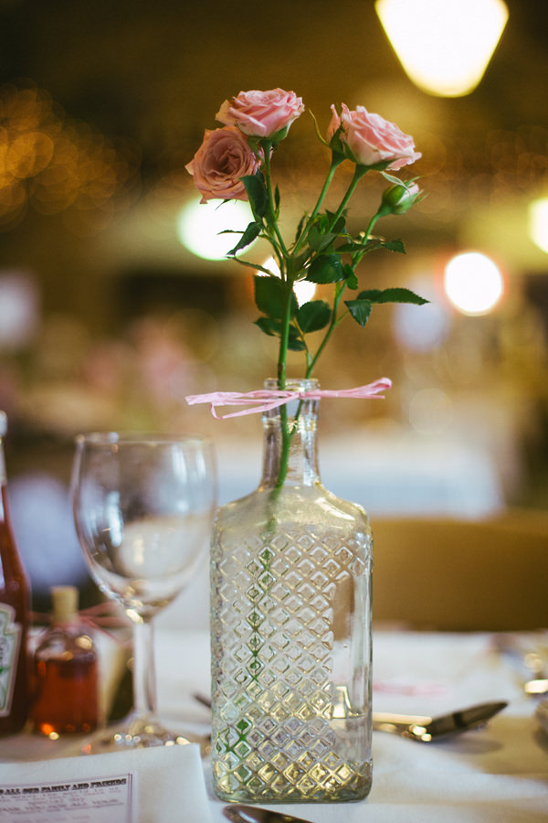 Quirky Stylish Barn Wedding Bottle Roses http://www.mikeandtom.co.uk/