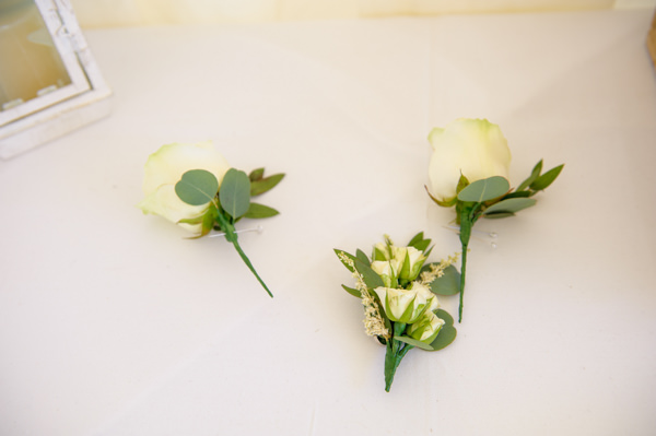 Natural Pretty Pastel Beach Wedding Rose Buttonholes http://annamorganphotography.co.uk/