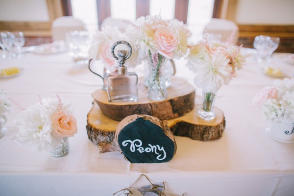 Stylish White DIY Floral Filled Barn Wedding Peony Jar Flowers Logs http://www.chrisbarberphotography.co.uk/