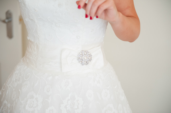 Justin Alexander Lace Brooch Dress Bride Red Nails Simple Warm Festive Winter Wedding http://mackphotography.co.uk/