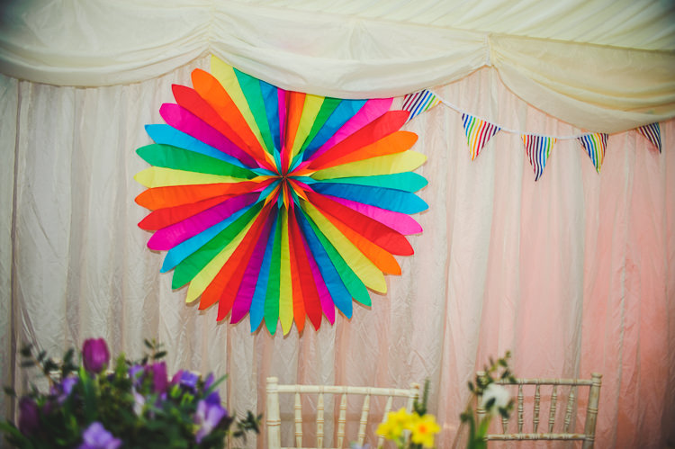 Rainbow Pinwheel Bright Multicolour DIY Skater Village Hall Herefordshire Wedding http://www.robfarrellphotography.co.uk/