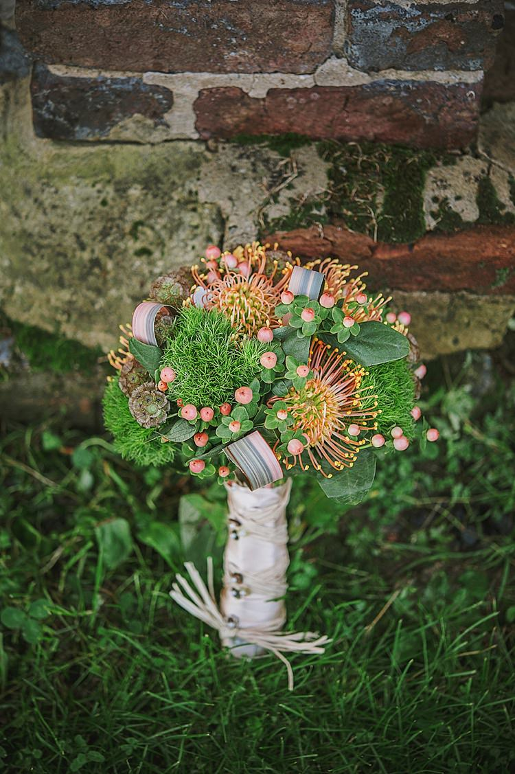 Orange Green Protea Berries Seeds Foliage Flowers Bouquet Bride Bridal Relaxed Rustic Autumn Barn Wedding http://karenflowerphotography.com/