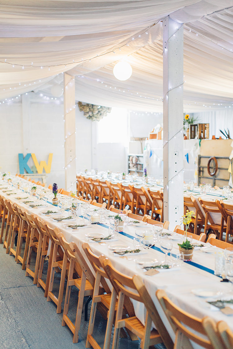 Drapes Bard Fairy Lights Long Tables Wooden Chairs Chilled DIY Beach Front Cafe Cornwall Yellow Blue Wedding http://missgen.com/
