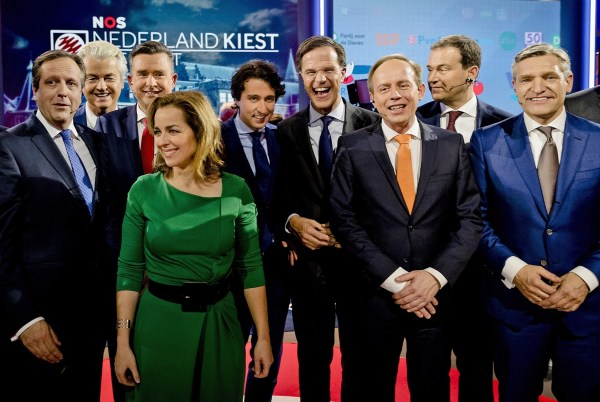 Democrats 66 party leader Alexander Pechtold, right-wing populist leader Geert Wilders, Socialist Party leader Emile Roemer, Party for the Animals' Marianne Thieme, Green Left party leader Jesse Klaver, Dutch Prime Minister Mark Rutte, Gert-Jan Segers of the Christian Union, Labour Party leader Lodewijk Asscher, and Christan Democrats party leader Sybrand Buma, from left, pose for a picture after the closing debate at parliament in The Hague, Netherlands, Tuesday, March 14, 2017. Amid unprecedented international attention, the Dutch go to the polls Wednesday in a parliamentary election that is seen as a bellwether for the future of populism in a year of crucial votes in Europe. (Robin van Lonkhuijsen ANP POOL via AP)