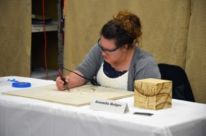 Amanda Bulger working on a wood burning