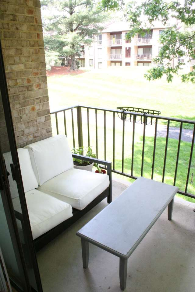 Our little sunny balcony - with a nice view of the trees and trails in our condo community.