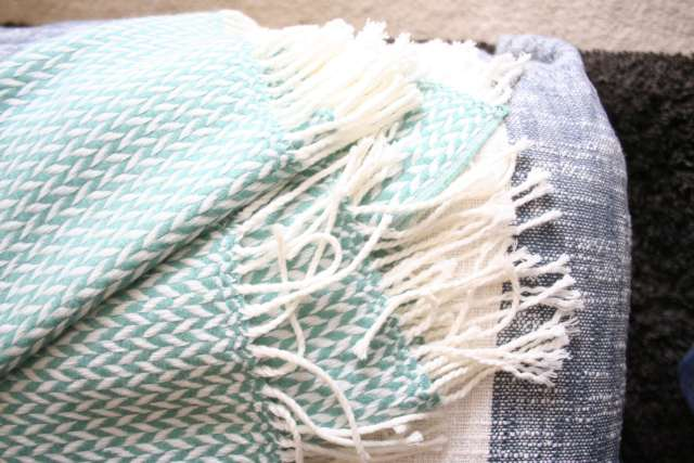 A cozy blanket throw, also from West Elm.