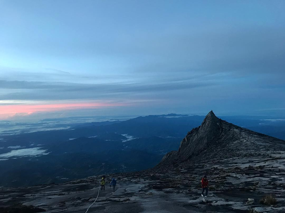 Me and the wife making our way up to the summit while the sun rising behind us. Slowly, but surely.  #NaimiSabahBha  Thanks @ainolhayati for the picture!