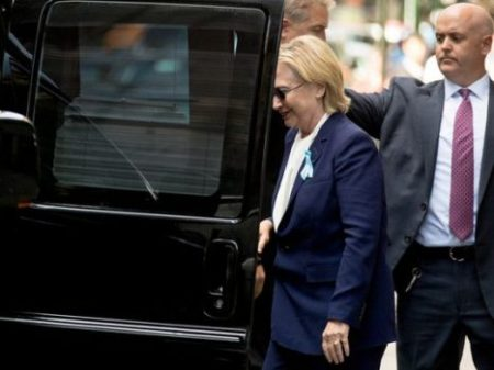 """Democratic presidential candidate Hillary Clinton gets into a van as she departs an apartment building Sunday, Sept. 11, 2016, in New York. Clinton's campaign said the Democratic presidential nominee left the 9/11 anniversary ceremony in New York early after feeling """"overheated."""" (Photo: Andrew Harnik, AP)"""
