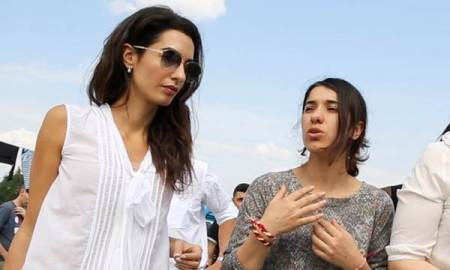 Amal Clooney talks with Yazidi activist Nadia Murad at a refugee camp in Greece. (Jake Whitman)
