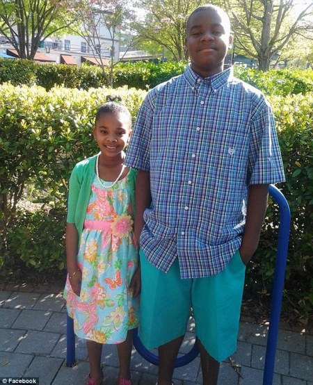 Siblings Daveon and Tatiyana Coates, pictured together here on Mother's Day in 2014, were shot dead during a home invasion on Saturday morning in Jonesboro, Georgia (PHOTO CREDIT: Facebook)