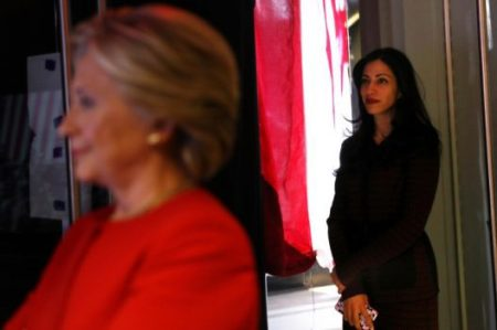 Hillary Clinton (left) and her longtime aide Huma Abedin stand backstage at a campaign rally in North Carolina. (Photo: Getty Images)