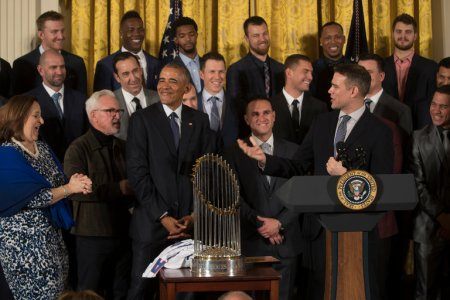 President Obama with the World Series champion Chicago Cubs on Monday. Among them, at right, was Theo Epstein, the team's president for baseball operations. Credit Stephen Crowley/The New York Times