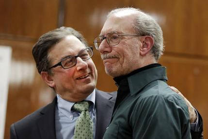 Stan Patz, right, father of 6-year-old Etan Patz who disappeared on the way to the school bus stop 38 years ago, reacts after a news conference with Assistant District Attorney Joel Seidemann, following the second trial of Pedro Hernandez, convicted of killing the boy, in New York's Manhattan Supreme Court, Tuesday, Feb. 14, 2017. (AP Photo/Richard Drew)