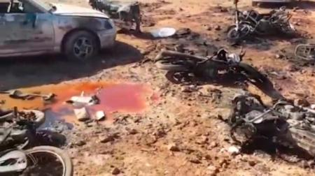 A still image taken from a video posted on social media uploaded on February 24, 2017, shows a pool of blood amid damaged motorcycles at a site of an Islamic State car bomb explosion, said to be in Sousian village near al-Bab, Syria. Social Media/ via REUTERS TV