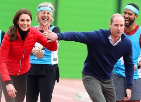 LONDON, ENGLAND – FEBRUARY 05: Catherine, Duchess of Cambridge and Prince William, Duke of Cambridge play about before they run a race during a training day for the Heads Together team for the London Marathon at Olympic Park on February 5, 2017 in London, England. (Photo by Danny Martindale/WireImage)