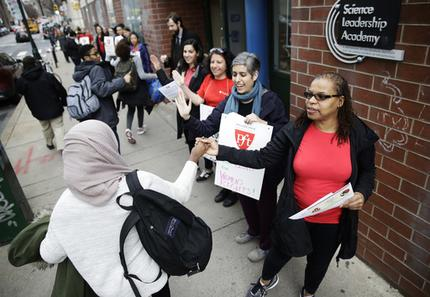 "Teacher Pia Martin greets students as they arrive to school at the Science Leadership Academy as teachers take part in ""A Day Without a Woman"" demonstration in Philadelphia, Wednesday, March 8, 2017. Organizers of January's Women's March are calling on women to stay home from work and not spend money in stores or online to show their impact on American society. (AP Photo/Matt Rourke)"