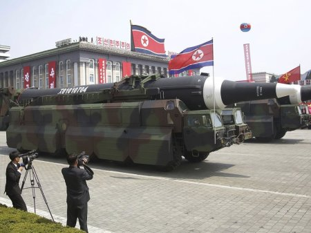 During a Saturday parade commemorating its founder's birthday, North Korea rolled out what appeared to be new intercontinental ballistic missiles. The country has been warned against having such weapons. (Wong Maye-E/AP)