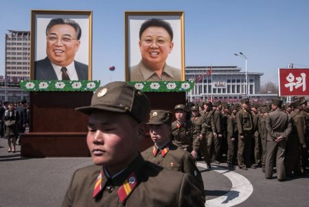 Portraits of Kim Il-sung, left, and Kim Jong-il, the first two leaders of North Korea, in Pyongyang, the capital, on Thursday. Kim Il-sung's birthday is on Saturday, an occasion often marked by shows of military might. (Ed Jones/Agence France-Presse — Getty Images)