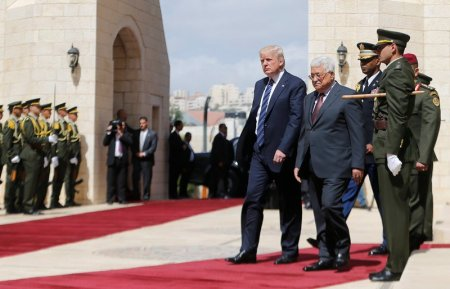 U.S. President Donald Trump and Palestinian President Mahmoud Abbas review the honor guard during a reception ceremony at the presidential headquarters in the West Bank town of Bethlehem, May 23, 2017. REUTERS/Mohamad Torokman