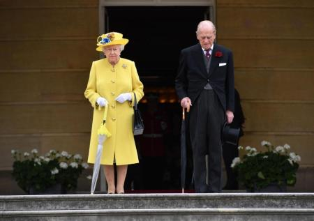 The Queen and the Duke of Edinburgh led their guests at a Buckingham Palace garden party in a minute's silence, pictured, in tribute to those killed in the Manchester terror attack