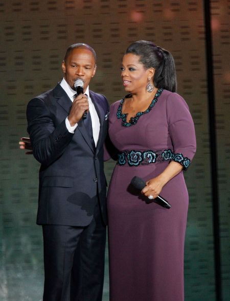 "Jamie Foxx sings to Oprah Winfrey during a star-studded double-taping of ""Surprise Oprah! A Farewell Spectacular,"" Tuesday, May 17, 2011, in Chicago. ""The Oprah Winfrey Show"" is ending its run May 25, after 25 years, and millions of her fans around the globe are waiting to see how she will close out a show that spawned a media empire. (AP Photo/Charles Rex Arbogast)"