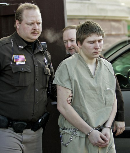 """FILE - In this March 3, 2006 file photo, Brendan Dassey, is escorted out of a Manitowoc County Circuit courtroom in Manitowoc, Wis. Dassey, whose homicide conviction was overturned in a case profiled in the Netflix series """"Making a Murderer"""" was ordered released Monday, Nov. 14, 2016, from federal prison while prosecutors appeal. Dassey's supervised release was not immediate and is contingent upon him meeting multiple conditions. (AP Photo/Morry Gash, File)"""