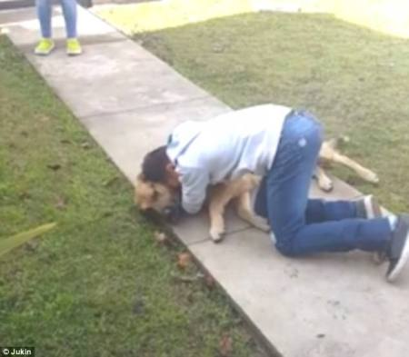 Together again: The boy sobs tears of joy as he hugs the dog