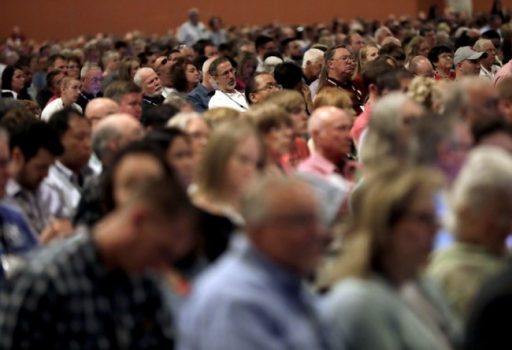 People attend the Southern Baptist Convention annual meeting Tuesday in Phoenix. (Matt York/AP)