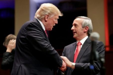 (PHOTO: REUTERS/YURI GRIPAS) U.S. President Donald Trump (L) is greeted by Pastor Jeffress at the Celebrate Freedom Rally in Washington, U.S. July 1, 2017.