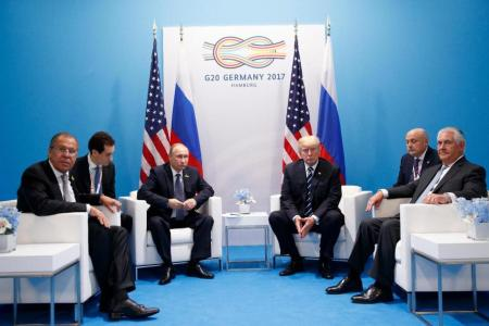 FILE – In this Friday, July 7, 2017, file photo, President Donald Trump meets with Russian President Vladimir Putin at the G20 Summit, in Hamburg. A separate US-Russia-brokered truce for southern Syria, brokered by the U.S. and Russia, is meant to help allay growing concerns by neighboring Jordan and Israel about Iranian military ambitions in the area. Russian Foreign Minister Sergey Lavrov is at left, Secretary of State Rex Tillerson is at right. (AP Photo/Evan Vucci, File)