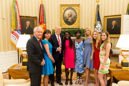 "President Donald Trump and his daughter Ivanka flank Chibok schoolgirls (left to right) Joy Bishara and Lydia Pogu. At far left is Doug Wead, president of the school the girls attend, and his wife, Myriam. Two of his daughters are at the right. This White House ""Photo of the Day"" was taken on June 27. Shealah Craighead/White House"