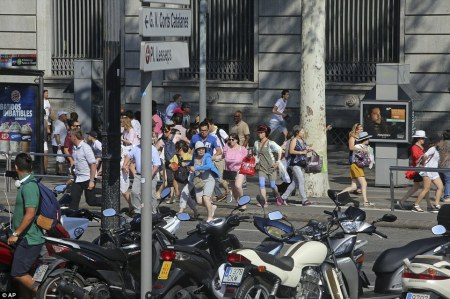 People flee after the van drove into crowds in the center of Barcelona. People flee after the van drove into crowds in the center of Barcelona.