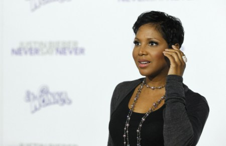 "(PHOTO: REUTERS/MARIO ANZUONI) Singer Toni Braxton poses at the premiere of the documentary ""Justin Bieber: Never Say Never"" at Nokia theatre in Los Angeles February 8, 2011."