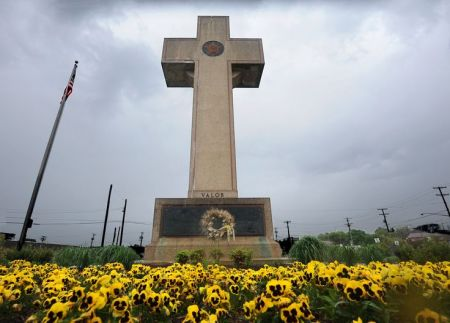 Bladensburg, MD - 5/7/14 - Pictured is the World War I memorial cross at 4500 Annapolis Road. The Bladensburg Peace Cross, as the local landmark is known, was dedicated in 1925 as a memorial to Prince George's County's World War I dead. Now the American Humanist Association is suing the Maryland-National Capital Park and Planning Commission for its removal as a violation of the constitutional separation of church and state. The American Legion, which wants the cross to be left where it is, is asking a federal court for standing in the case. Algerina Perna/Baltimore Sun--#1260.