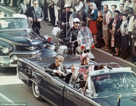 Jack Ruby made comments on the morning of President John F Kennedy's assassination to an FBI informant that suggested he knew what was about to take place, according to new records released Friday. JFK and Jackie Kennedy are pictured just moments before he was shot