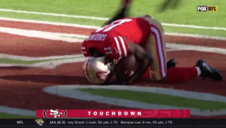 (SCREENSHOT: FOX NFL) Marquise Goodwin of the San Francisco 49ers gets on his knees after scoring a touchdown, Nov. 12, 2017.