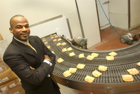 Lowell Hawthorne, who committed suicide yesterday in his Bronx factory, was President and CEO of Golden Krust Caribbean Bakery and Grill. In this 2004 file photo, he is shown in his factory. Photo credit: Helayne Seidman