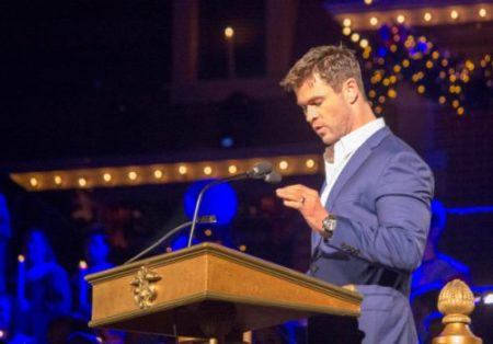 """Chris Hemsworth, known on-screen as the character of """"Thor"""" in the Marvel Cinematic Universe, narrates the story of the first Christmas during Disneyland's Candlelight Ceremony, Saturday, Dec. 2, 2017. (Photo by Mark Eades, Contributing Photographer)"""