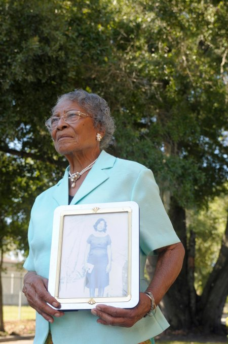 FILE- In this Oct. 7, 2010, file photo, Recy Taylor, 90, holds a photo of herself from her days in Abbeville, Ala., outside her home in Winter Haven, Fla. Taylor, a black Alabama woman whose rape by six white men in 1944 drew national attention, died Thursday, Dec. 28, 2017, according to her brother Robert Corbitt. She was 97. (AP Photo/Phelan M. Ebenhack, File)