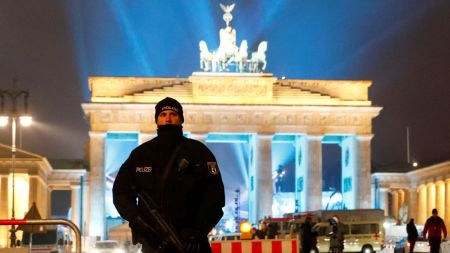 A German police man guards the venue at the Brandenburg Gate, during the upcoming New Year's Eve celebrations in Berlin, Germany, December 31, 2016. REUTERS/Fabrizio Bensch - RTX2X2W7
