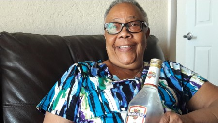 "Hazel Bethel is a Manischewitz wine devotee. She's originally from Trinidad and was introduced to the wine by friends who worked in Jewish homes in New York. (Credit: Nadege Green/PRI)"" width=""937"" height=""528"" /> Hazel Bethel is a Manischewitz wine devotee. She's originally from Trinidad and was introduced to the wine by friends who worked in Jewish homes in New York. (Credit: Nadege Green/PRI)"