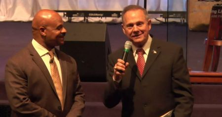 Roy Moore speaks at Guiding Light Church in Birmingham. Pastor Bishop Jim Lowe, Jr. stands to his left