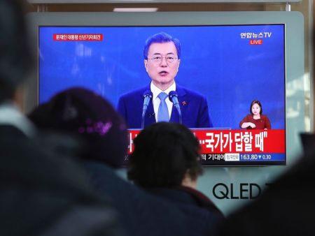 People watch a live broadcast of South Korean President Moon Jae-in's New Year's speech at the Seoul Railway Station in Seoul, South Korea, Wednesday, Jan. 10, 2018. The Associated Press