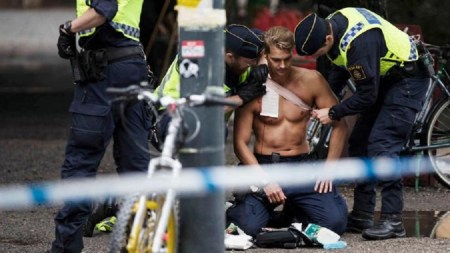 Police officer Ted Eriksson is treated in Stockholm last summer after he was stabbed in the neck by an asylum seeker (LISA MATTISSON/TT NEWS AGENCY)